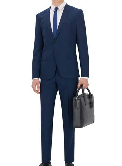 Costume bleu pour homme. texture finement tissée.