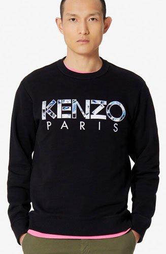 """Sweatshirt Kenzo """"Paris"""" à manches longues. Logo KENZO brodé sur la poitrine avec empiècement imprimé """"KENZO World""""."""